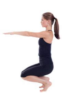 Utkatasana involves sitting in the chair position.